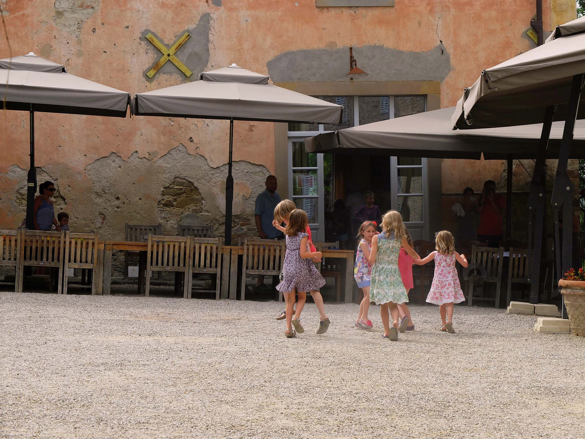children playing outside in the courtyard