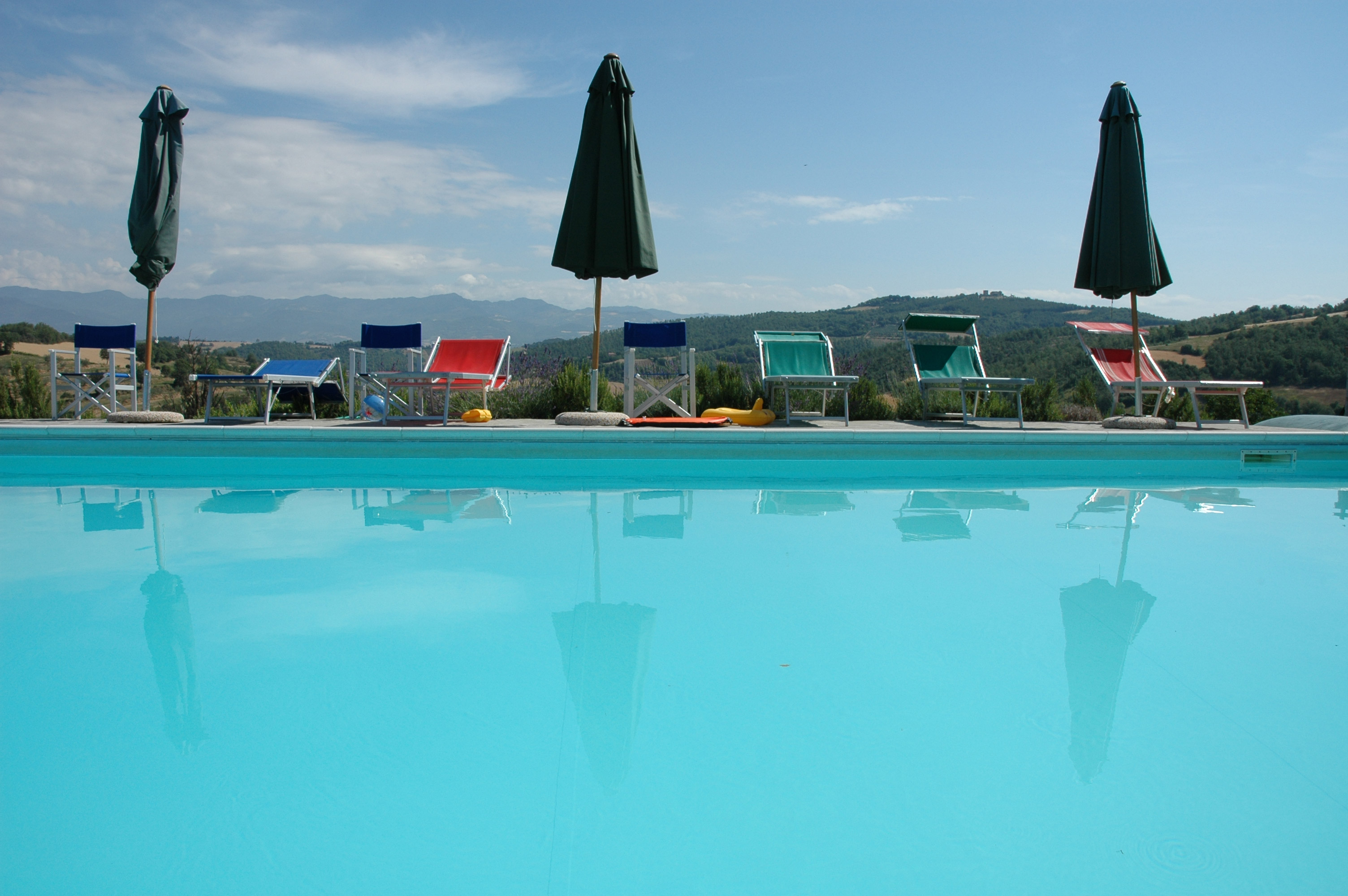 swimming pool and sun loungers