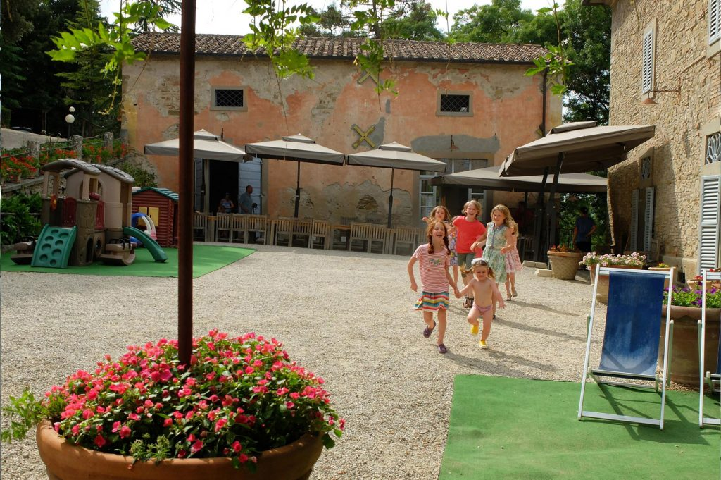 children running in the courtyard