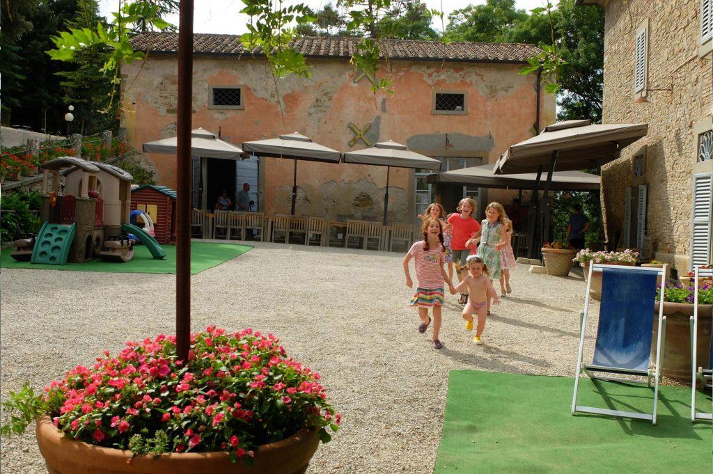 children running in the courtyard
