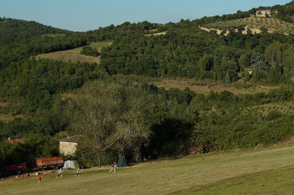 children running in open countryside